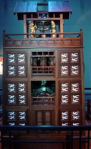 A scale model of Su Song's Astronomical Clock Tower, built in 11th century Kaifeng, China. It was driven by a large waterwheel, chain drive, and escapement mechanism.