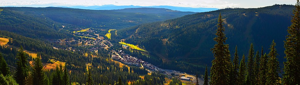 Panorama of Sun Peaks resort as seen from the Tod Mountain early morning in autumn.