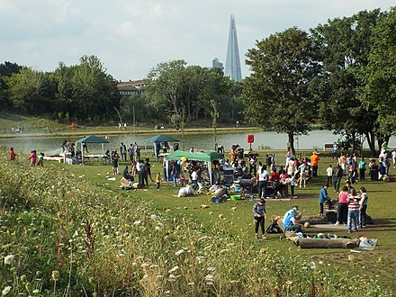 The park in 2013 Sunday barbecues by the lake, Burgess Park (geograph 3899024).jpg