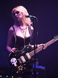 Momsen performing at the Warped Tour Kick-Off Party in April 2010
