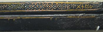 Middle section of a seax, showing inlaid wire decoration