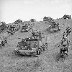 53rd (Welsh) Infantry Division - Universal Carriers and motorcycles of the 1/4th Battalion, Welch Regiment, on manoeuvres at Keady in County Antrim, Northern Ireland, 22 July 1941.