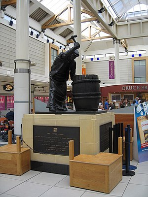 James Butler (artist) - The Burton Cooper (1977), Cooper's Square Shopping Centre, Burton on Trent. The bronze sculpture was commissioned in 1977 and depicts a local craftsman. It originally stood opposite the market and was moved to its present location in 1994.