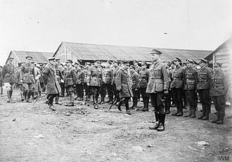 59th (2nd North Midland) Division - King George V and General Henry Horne inspecting men of the 2/6th Battalion, South Staffordshire Regiment at Gauchin, 30 March 1918. They are accompanied by Brigadier General T. G. Cope and Major General Cecil Romer.