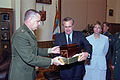 The Honorable Donald H. Rumsfeld, U.S. Secretary of Defense, and the Ukrainian Minister of Defense, General of the Army Olekasander Kuzmuk exchange gifts at Kiev, Ukraine, on Jun. 5, 2001 010605-D-WQ296-060.jpg