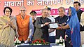 The President, Shri Pranab Mukherjee distributing the keys and ownership certificates for EWS houses built under the Integrated Housing & Slum Development Project, at Jiwaji University, in Gwalior (2).jpg
