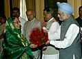 The Prime Minister, Dr. Manmohan Singh presenting the bouquet to the President, Smt. Pratibha Devisingh Patil on her departure to Lao PDR and Cambodia, at Rashtrapati Bhavan, in New Delhi on September 09, 2010.jpg