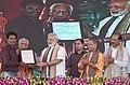 The Prime Minister, Shri Narendra Modi felicitating the beneficiaries of various schemes, at a function, in Varanasi, Uttar Pradesh (2).jpg