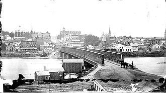 Dixon Bridge Disaster - On May 4, 1873, the heaviest crowds gathered on the sidewalk, near the location of the horse and buggy in this photo.