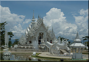 Wat Rong Khun, located just south of Chiang Ra...
