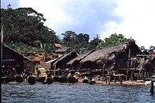 Tiagba with its traditional houses on stilts and dug-out canoes Tiagba3.jpg