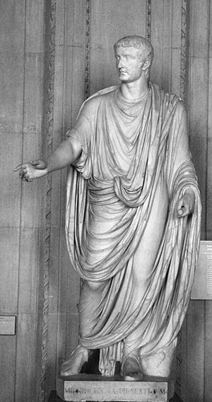 Clothing in ancient Rome - Statue of the Emperor Tiberius showing the draped toga of the 1st century AD.