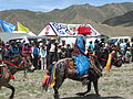 Tibetan festival with tents in the background.JPG
