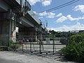 Tokaido Shinkansen materials stockyard under Yamada river bridge.jpg