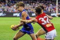Tomas Bugg and Alex Neal-Bullen tackling Shane Biggs.jpg