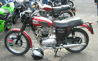 Triumph Tiger 100 - Early 1960s Triumph Tiger 100 with the new unit 500 cc engine, similar to Bob Dylan's personal machine. This example has a thicker aftermarket dual seat.