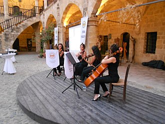Culture of Northern Cyprus - Musicians from the Lefkoşa Municipal Orchestra performing in Büyük Han