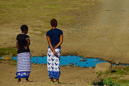 Two women wearing Kangas