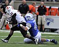 U.S. Air Force Academy (USAFA) Senior linebacker James Chambers, right, tackles Idaho State Bengals' Xavier Finney as the USAFA Falcons against the Bengals at Falcon Stadium in Colorado Springs, Colo., Sept 120901-F-JM997-710.jpg