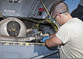 U.S. Air Force Airman 1st Class Brent Norder, a student with the 362nd Training Squadron, checks the oil level in a C-130 Hercules aircraft engine June 16, 2011, at Sheppard Air Force Base, Texas 110616-F-NS900-002.jpg