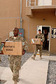 U.S. Airmen with the 451st Air Expeditionary Wing move boxes of donated Christmas stockings at Kandahar Airfield, Afghanistan, Dec. 4, 2013 131204-F-XI929-228.jpg