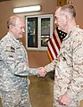 U.S. Army Gen. Martin E. Dempsey, left, the chairman of the Joint Chiefs of Staff, shakes hands with U.S. Marine Corps Gen. Joseph F. Dunford Jr., the outgoing commander of the International Security Assistance 140826-D-HU462-362.jpg