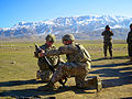 U.S. Army Sgt. 1st Class Shannon Zentz, left, prepares to load a mortar round for Sgt. Angel Garcia to fire in Pul-e-Khomri, Baghlan province, Afghanistan, Dec. 23, 2013 131223-A-CR409-940.jpg
