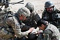 U.S. Army Sgt. Jon Allen, left, a medic with Company B, 1st Battalion, 2nd Infantry Regiment, helps an Afghan National Army soldier injured by a blast from a rocket-propelled grenade during Operation Shamshir 111019-A-HQ885-038.jpg