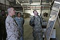 U.S. Marine Corps Sgt. Maj. Bryan B. Battaglia, left foreground, the senior enlisted adviser to the Chairman of the Joint Chiefs of Staff, reviews a chart outlining retrograde operations at Bagram Airfield 130504-A-CL397-215.jpg