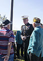 U.S. Marine Lt. Gen. Richard P. Mills, commander of Marine Forces Reserve and Marine Forces North, talks with U.S. Army veterans before the start of the Veterans Day ceremony at the Southeast La 131111-M-IJ438-155.jpg
