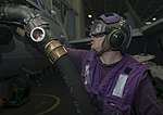 U.S. Navy Aviation Boatswain's Mate (Fuel) Airman Nicholas Flanagan prepares a F-A-18C Hornet aircraft assigned to Marine Fighter Attack Squadron (VMFA) 312- for fueling aboard the aircraft carrier USS 130819-N-GR168-012.jpg