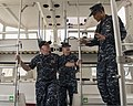 U.S. Navy Chief Hospital Corpsman Jashir Setias, right, discusses the capabilities of a rescue boat to Vice Adm. Matthew L. Nathan, left, the Navy surgeon general and the chief of the Bureau of Medicine 140629-N-OL084-292.jpg