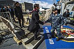 U.S. Navy Cmdr. Jonathan Schmitz, right, the commanding officer of the guided missile destroyer USS Fitzgerald (DDG 62), greets members of the Council on Foreign Relations as they board for a ship visit 140310-N-ZS026-006.jpg