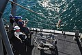 U.S. Sailors assigned to MCM Crew Dominant and deployed aboard the mine countermeasures ship USS Gladiator (MCM 11) launch an upgraded SeaFox portable mine neutralization system into the water during mine 130117-N-CG436-094.jpg
