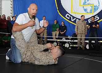 Keith Jardine - Jardine aboard USS Enterprise (CVN-65) demonstrating grappling techniques during a USO tour