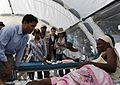 USAID Administrator Shah visits Haitian Earthquake Survior (4300960487).jpg