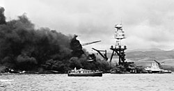 USS Arizona (BB-39) sinking during the attack.