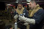 USS Carl Vinson general quarters drill 141205-N-TR763-042.jpg