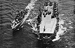 USS Gilbert Islands (CVE-107) and USS Hailey (DD-556) underway at sea, in 1954.jpg