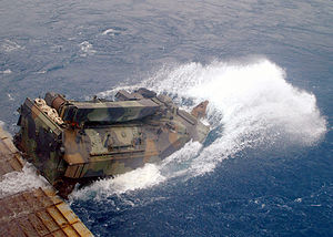 Assault Amphibious Vehicle - An AAVR-7A1 (Recovery vehicle) attached to the 31st Marine Expeditionary Unit splashes into the Pacific Ocean from the well deck of USS ''Juneau'' before heading to the beach.