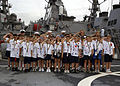 US Navy 030501-N-8787A-001 Students from the Spanish River Christian School, Boca Raton, Fla., salute with Sailors aboard USS Cole (DDG 67) after taking a ship's tour during Fleet Week USA.jpg