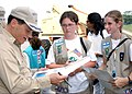 US Navy 040321-N-2386V-003 During a recent port visit to Singapore, Captain Thomas D. Crowley, Commanding Officer of the amphibious assault ship USS Boxer (LHD 4), thanks members of the Girl Scouts.jpg