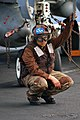 US Navy 040420-N-5781F-002 Airman Sandra Duran, of Queens, N.Y., crouches under the nose of an F-A-18F Super Hornet.jpg