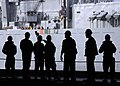 US Navy 040911-N-5384B-142 USS Abraham Lincoln (CVN 72) Weapons Department Sailors prepare to fire lines across to the fast combat support ship USS Camden (AOE 2) during an underway replenishment (UNREP).jpg