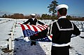 US Navy 050222-N-0020T-016 Boatswain's Mate 3rd Class Marcus Allen performs flag folding honors for a funeral service held at the Calverton National Cemetery in Long Island, N.Y.jpg