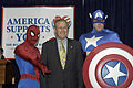 US Navy 050428-N-0295M-002 Secretary of Defense Donald Rumsfeld poses with superheroes Spider-Man and Captain America during the unveiling of a comic book that will be distributed free to U.S. forces in Iraq and around the worl.jpg