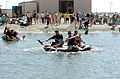 US Navy 050924-N-6843I-215 Teams participating in the Bayside Boat Bash race their vessels to a buoy 100-meters from shore.jpg