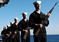 US Navy 060109-N-5946V-023 Members of the rifle team participate in a burial at sea ceremony aboard the nuclear-powered aircraft carrier USS Nimitz (CVN 68).jpg