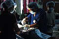 US Navy 060528-N-1577S-132 Robert Sy, a surgeon from Aloha Medical Mission, removes a cyst from a patient's back at Zamboanga Medical Center while the U.S. Military Sealift Command (MSC) hospital ship, USNS Mercy (T-AH 1.jpg