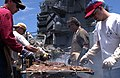 US Navy 060628-N-7130B-050 On the flight deck of the Nimitz-class aircraft carrier USS Ronald Reagan (CVN 76), members of the Anton Group alongside Sailors, grill steaks for the crew and embarked air wing during a steel beach.jpg